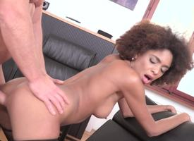 Coily-haired beauty is fucked surrounding the office