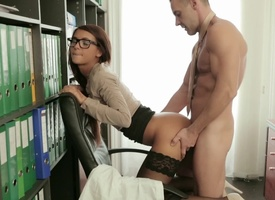 A small breasted minx is fucked from behind all round the office