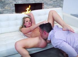 A blonde with a nice pussy is sitting on top of a big firm cock